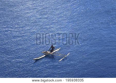 Locals In Traditional Canoe, Garove Island, Papua New Guinea.