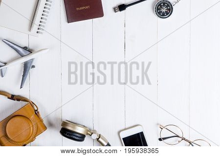 Travel accessories and gadget on whtie wooden copy space