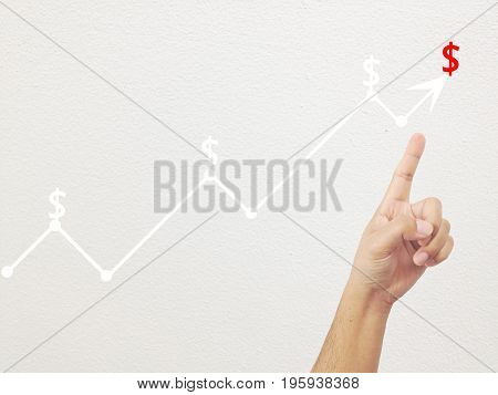 Finger of Businessman touch line graph business in peak point,concept of business investment and profits and assessed.