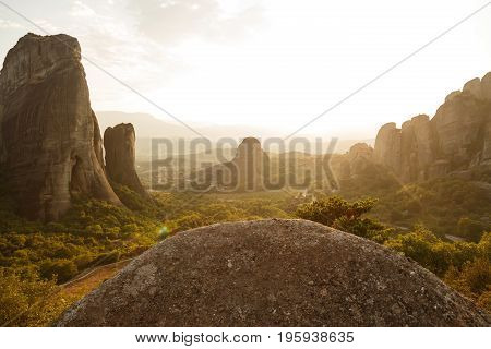 Pinnacles of rocks in Meteora landscape panorama at sunset, Greece.