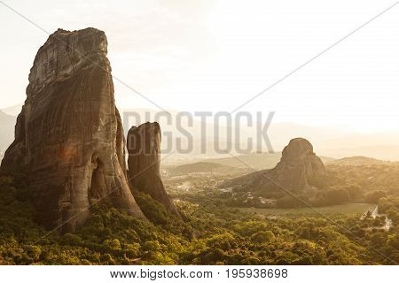 Breathtaking view of rocks of Meteora at sunset, Greece. Geological formations of big rocks with Monasteries at the top of them