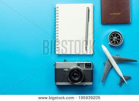 Travel blogger writer accessories on blue copy space