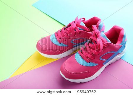 Sport shoes on the colorful paper background