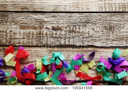 Colored confetti on a grey wooden table