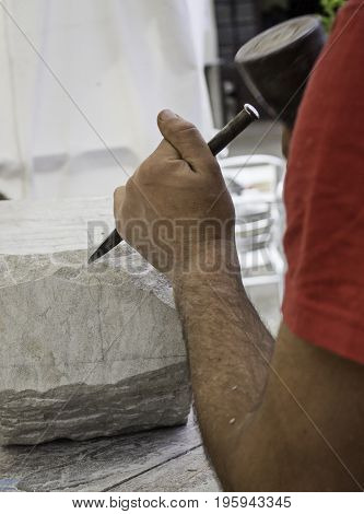 Man Working And Carving Stone