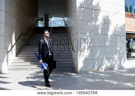Business executive walking in the street after day of work