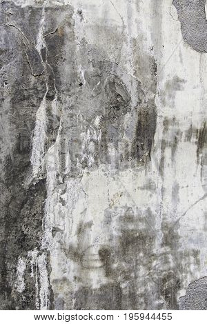 Concrete background with dampness and ruin detail of an old abandoned wall