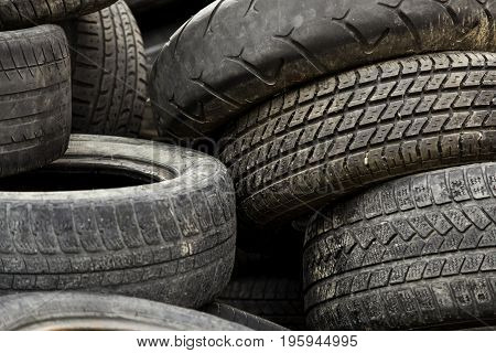 Old Car Tires In A Dump