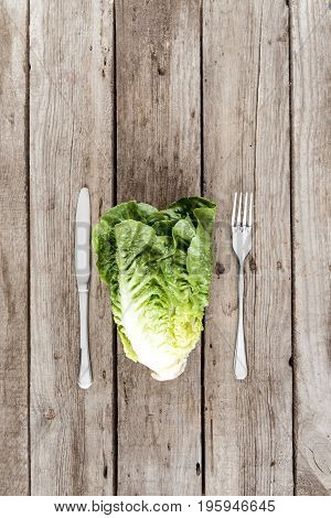 Top View Of Fresh Letuce Salad With Fork And Knife On Wooden Table, Healthy Eating Concept