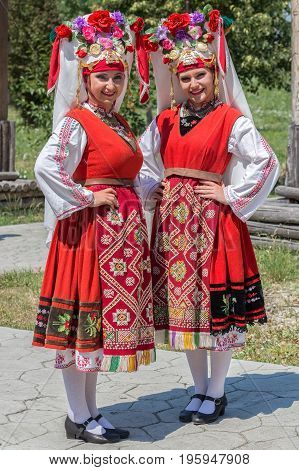 TIMISOARA ROMANIA - JULY 9 2017:Portrait of dancer girls from Bulgaria in traditional costume present at the international folk festival