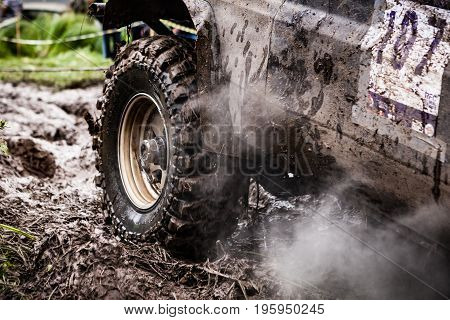 LUBOTIN UKRAINE - JULY 23 2016: RFC Ukraine Wild Boar Challenge 2016. Close up of off-road car in mud.