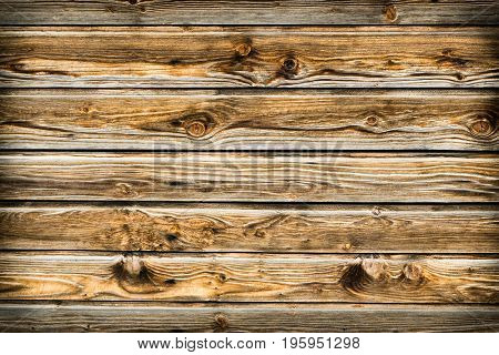 Natural brown barn wood wall. Wooden wall background design. Wood planks, boards are old with a beautiful rustic look. Timber design style.
