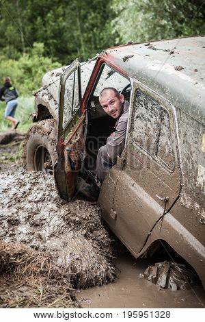LUBOTIN UKRAINE - JULY 23 2016: RFC Ukraine Wild Boar Challenge 2016. Portrait of participant on UAZ 469.