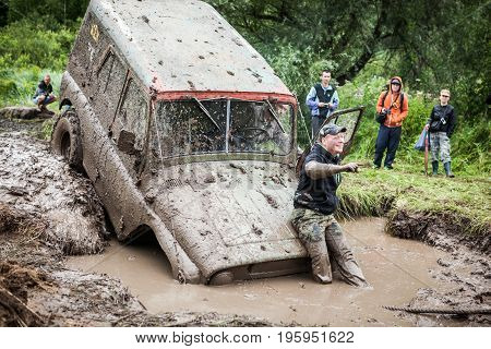 LUBOTIN UKRAINE - JULY 23 2016: RFC Ukraine Wild Boar Challenge 2016. Off-road Trophy UAZ 469 stucks in mud pit.