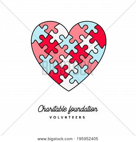 Puzzle Heart vector colorful charitable foundation or volunteerism concept logo. Relationship teamwork and connection symbol.