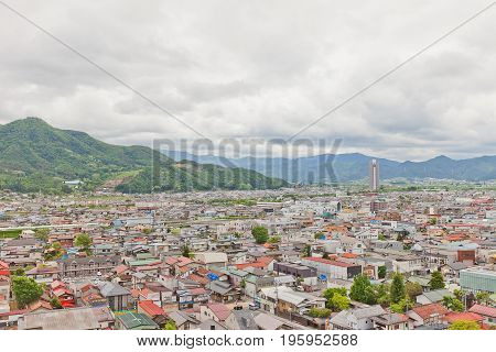 KAMINOYAMA JAPAN - MAY 28 2017: View of Sankichiyama Mount and Kaminoyama City from donjon of Kaminoyama Castle. Sky Tower 41 skyscraper is in the right corner