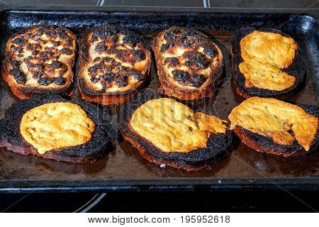 burnt grilled cheese are on the baking sheet