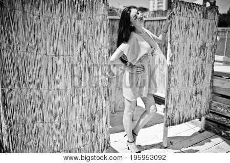 Young Gorgeous Woman Having Fun In The Changing Room By The Lake. Black And White Photo.