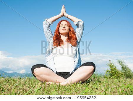 Redhead Yoga Woman In Meditation Pose