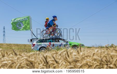 Saint-Quentin-Fallavier France - July 16 2016: The family mascot of Skoda during the passing of Publicity Caravan in a wheat plain in the stage 14 of Tour de France 2016. Skoda provides the official car of the competition and it sponsors The Green Jersey.