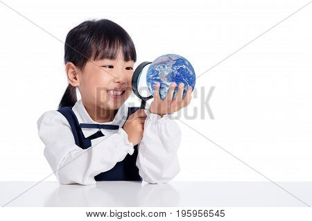 Asian Little Chinese Girl Looking At Globe Through Magnifying Glass