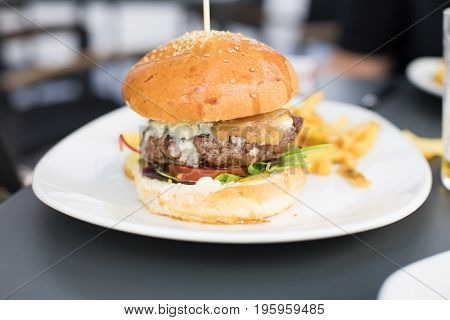 Burger With Chips In White Dish