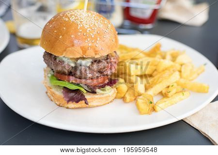 Burger With French Fries At Restaurant