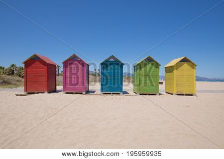 Five Colored Bathing Huts At Beach In Grao Of Castellon