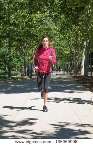 Front Woman Running In Park