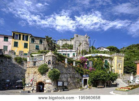 PORTO VENERE ITALY - 18 JUNE 2017 - Summer scene of colorful buildings in the pretty seaside town of Porto Venere designated by UNESCO as a World Heritage Site