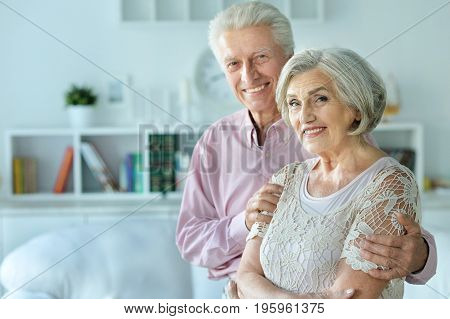 Portrait of a happy senior couple indoors