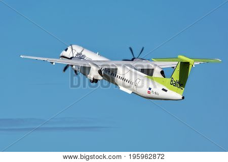 Riga, LV - JULY 16, 2017: AirBaltic Airplane Over Riga International Airport