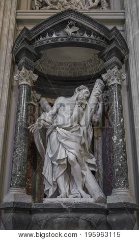 Sculpture of the apostle St. Andrew by Camillo Rusconi on the nave of the Archbasilica of St John Lateran in Rome Italy. Rome Italy June 2017