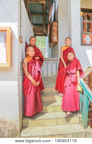 Phuentsholing Bhutan - September 16 2016: Young Bhutanese monks standing on the stairs of a monastery at Phuentsholing Town Bhutan South Asia
