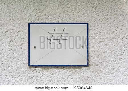 Information sign or board on a house wall with lettering #