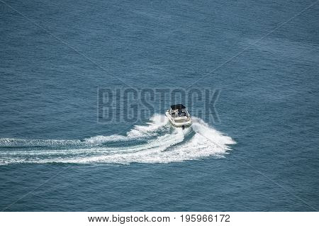 high speed motor boat with wave trail on the water