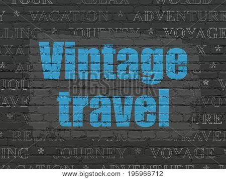 Tourism concept: Painted blue text Vintage Travel on Black Brick wall background with  Tag Cloud