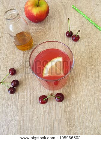 Sour lemonade with sour cherries, lemon and apple vinegar