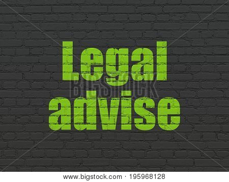 Law concept: Painted green text Legal Advise on Black Brick wall background
