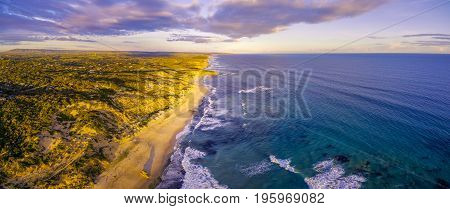 Aerial panoramic view of beautiful ocean coastline at sunset