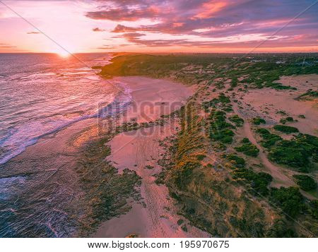Aerial view of beautiful sunset over sandy beach on Mornington Peninsula Australia