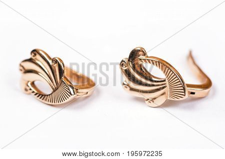 Gold pieced earrings pair fine jewelry isolated on white