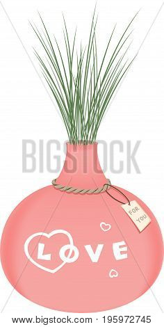 Pink vase filled with plant and the hanging note.