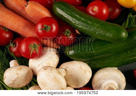 Top view of a raw vegetables. View from above of a Fresh vegetable. Colorful vegetables background. Healthy vegetable studio photo. Assortment of fresh vegetables on dark stone kitchen table.