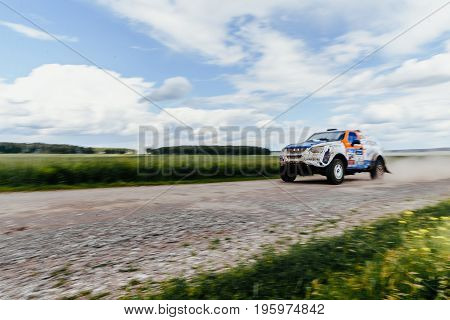Russia - July 10 2017: blurred motion rally car driving on gravel road during Silk way rally