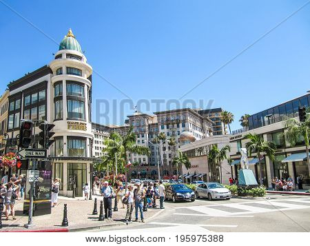 Los Angeles, Usa - May 25, 2010: Rodeo Drive With People, Stores And Road With Cars