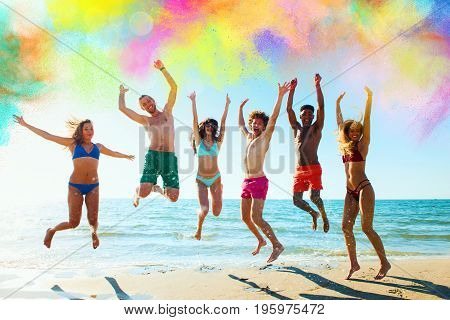 Happy friends jump into the air between an explosion of colors