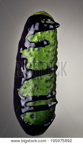 Cucumber With Pouring Blue Paint On Gray Background. Fashion Food Concept.creative.