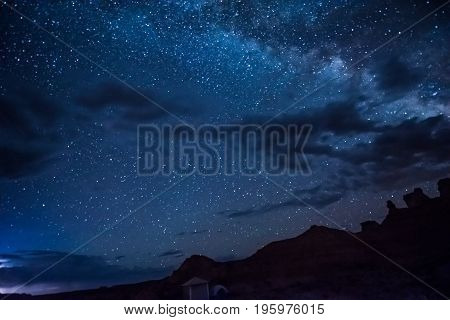 Night Sky With Milky Way, Clouds, Canyons And Campground