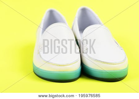 Female Moccasins In White Color. Pair Of Female Leather Shoes